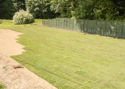 Laying turf for a croquet lawn